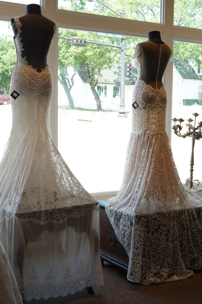 "Beautiful Views at The Blushing Bride boutique in Frisco, Texas with ""Nobility"" and ""Superior"" by Naama and Anat Couture"