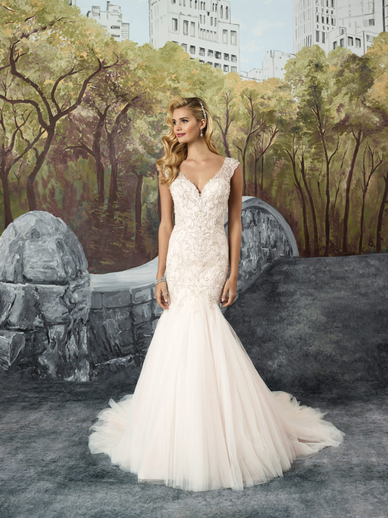 Justin Alexander 8914 - Allover lace with hand beading add a romantic depth to this stunning fit and flare style. With a V-neckline and V-back and tulle mermaid skirt, this dress has a sexy, modern edge - The Blushing Bride boutique in Frisco, Texas