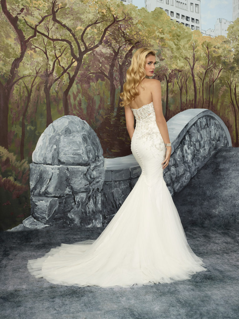Justin Alexander 8917 - The soft rich tulle of this fit-and-flare gown is side draped for just the right fit. Adorned with elegant beaded appliques, this style is meant to inspire the classic bride with its romantic illusion back covered in beaded lace appliques - The Blushing Bride boutique in Frisco, Texas