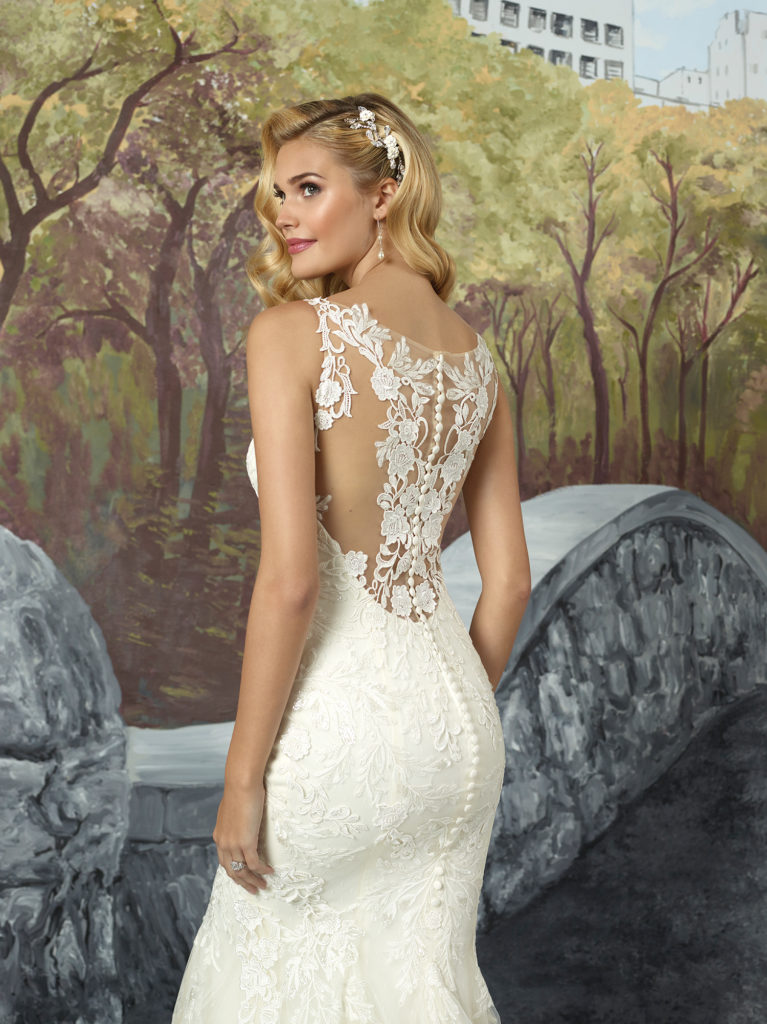 Justin Alexander 8922 - This timeless fit and flare wedding dress is jersey lined for comfort. Hand placed Venice lace covers delicate illusion straps and a romantic illusion back. Overall point d'esprit tulle is adorned with hand place Venice to take this gown from romantic to unforgettable - The Blushing Bride boutique in Frisco, Texas