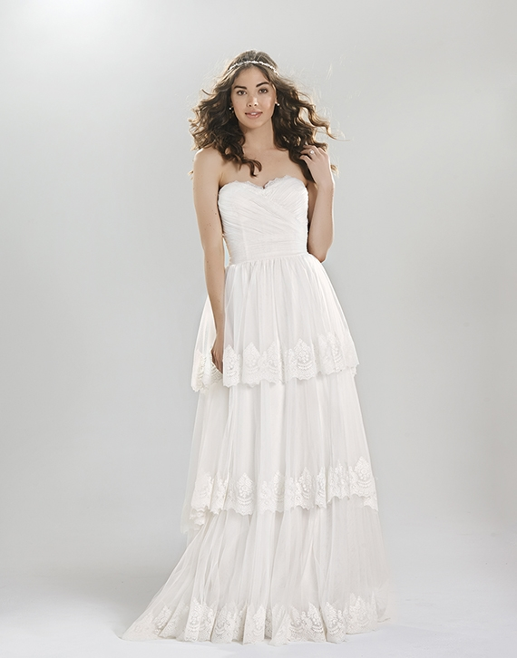 Soft draped English net A-line with peek-a-boo lace at sweetheart neckline, tiers of tulle and stretch Jersey lining / Off the Rack Bridal - The Blushing Bride boutique in Frisco, Texas