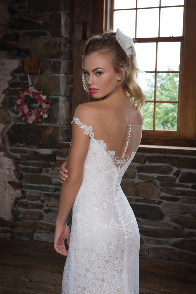 Sweetheart Gown 1113 - This flirty style is accented by an illusion neckline with off the shoulder lace straps. The fit and flare silhouette is feminine and girly, with a sweetheart neckline and allover lace - The Blushing Bride boutique in Frisco, Texas
