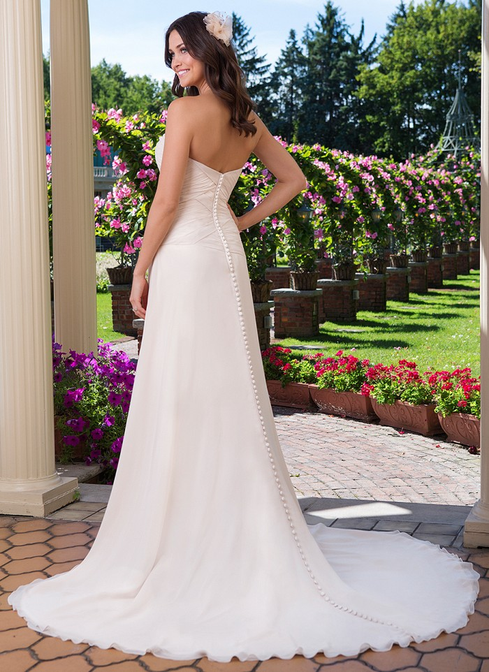 Sincerity Bridal JA 3920 - A strapless earth toned A-line gown that features an asymmetrical waistline with a beaded motif at the hip to create a slimming focal point. Off the Rack Bridal - The Blushing Bride boutique in Frisco, Texas