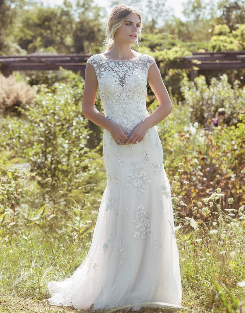 Lillian West 6498 - Unique beaded floral embroidery adorns this ethereal fit and flare gown. The illusion Sabrina neckline has a vintage feel. Satin lining adds a layer of comfort and the illusion back with embroidered florals adds a touch of romance - The Blushing Bride boutique in Frisco, Texas