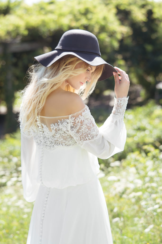 Lillian West 6476 - The epitome of boho-chic; blouson sleeves and lace off-the-shoulder detailing, this effortless chiffon gown will make your day feel ethereal and light - The Blushing Bride boutique in Frisco, Texas