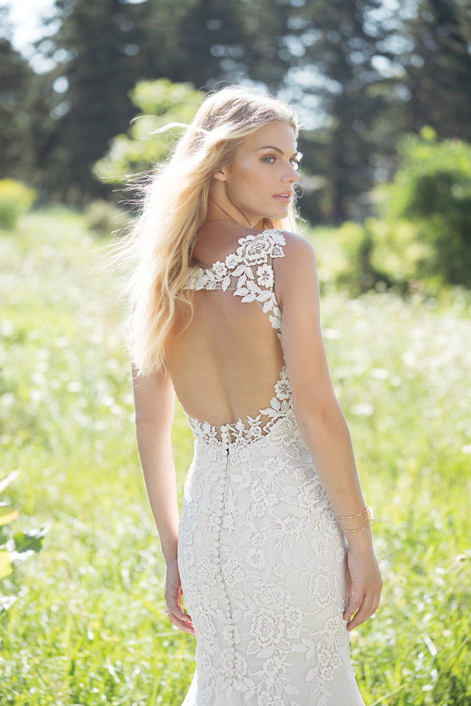 Lillian West 6486 - Romantic florals adorn this fit and flare and flawlessly frame the boho-chic bride on her wedding day. The timeless keyhole back adds just enough sex appeal to this ethereal style - The Blushing Bride boutique in Frisco, Texas