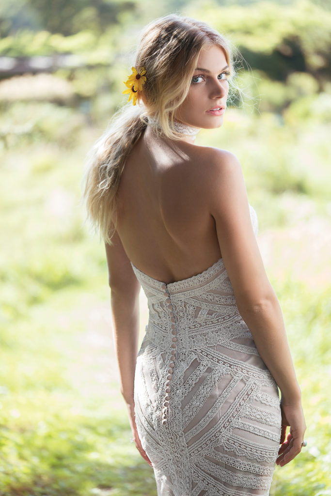 Lillian West 6492 - Unique hand placed geometric lace makes this fit and flare gown standout from all the rest. The sweetheart neckline adds a romantic touch to this patchwork-inspired boho wedding dress, and the fit and flare skirt gives you the perfect silhouette - The Blushing Bride boutique in Frisco, Texas
