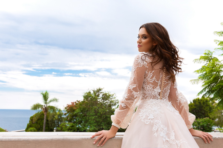long-sleeves-cuff-bishop-deep-v-neck-heavily-embellished-bodice-romantic-a-line-wedding-dress-sheer-back-chapel-train-alison-The-Blushing-Bride-boutique-Frisco-Texas