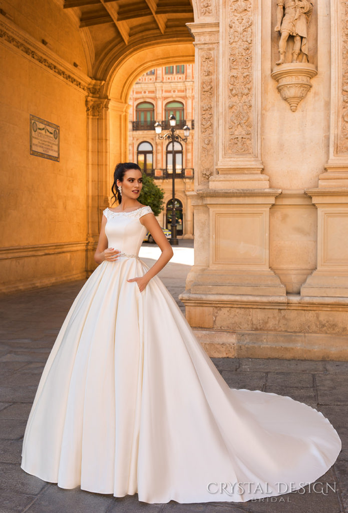 crystal-design-2017-Rafaella-bridal-off-the-shoulder-simple-clean-bodice-elegant-classic-ball-gown-a-line-wedding-dress-with-pockets-lace-back-royal-train-The-Blushing-Bride-boutique-in-Frisco-Texas