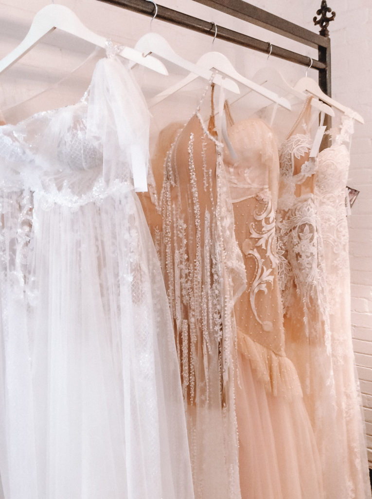 Delicate custom & couture wedding gowns by Naama & Anat Bridal. Made in Israel by this Daughter - Mother Team. Exclusively here in Texas at The Blushing Bride Boutique!